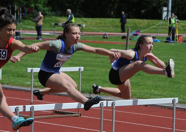 Peterborough and Nene Valley Athletic Club pair Pearl Ford and Sienna Slater in action in the under 13 girls hurdles at the Embankment. Photo: David Lowndes.