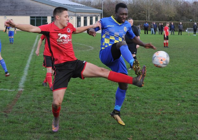 Peterborough Sports North End (blue) in action last season.