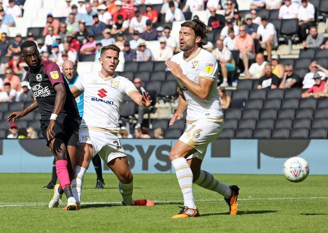 Mo Eisa scores for Posh against MK Dons in August, 2019. Current MK Dons maanager Russell Martin is also pictured. Photo: Joe Dent/theposh.com.