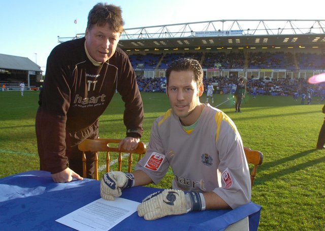Mark Tyler signs a new Posh contract watched by caretaker-manager Tommy Taylor.