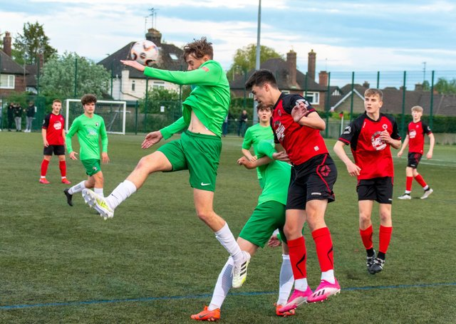 Play-off action from Netherton United Under 18s (red) v Dereham Town. Photo: Carl Rumble.