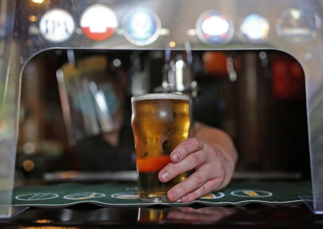 Peterborough pub-goers drink up to 146 pints per minute on Monday. Photo: PA EMN-210520-161453001