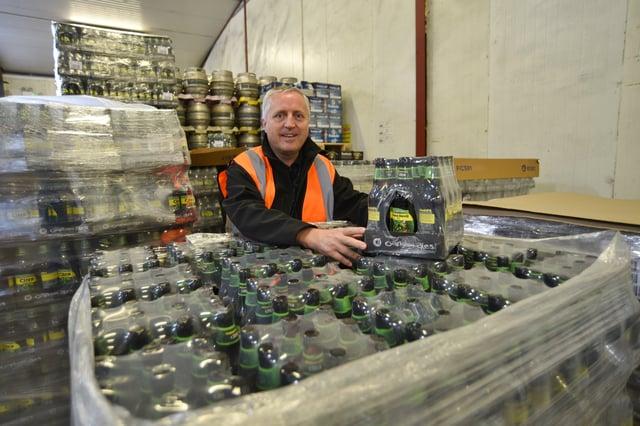 Oakham Ales's managing director Adrian Posnett checks a new brew. EMN-210513-131808009