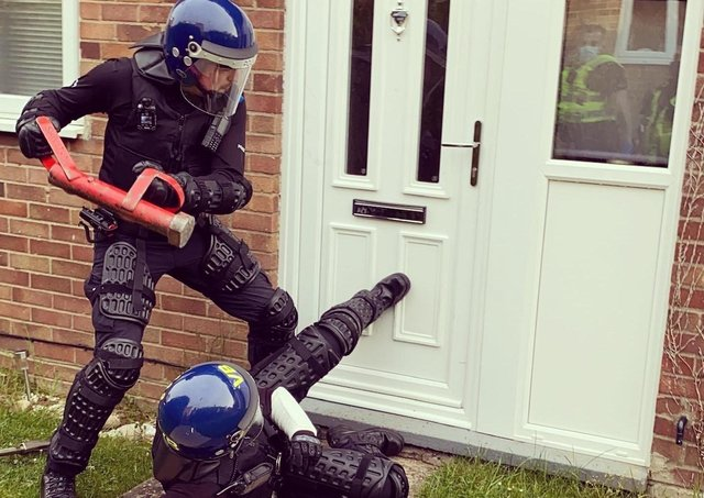 Police targeting county lines drug dealing operations raid a property.