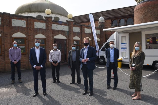 MP for Peterborough Paul Bristow with volunteers at the Burton Street mosque where a Covid-19 testing centre is operating EMN-210528-134613009