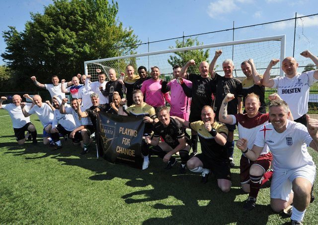 Marco Sementa with his teams celebrating his 150th charity football match.