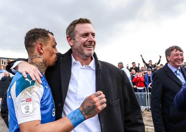 Posh co-owner Darragh MacAnthony (right) with star striker Jonson Clarke-Harris.