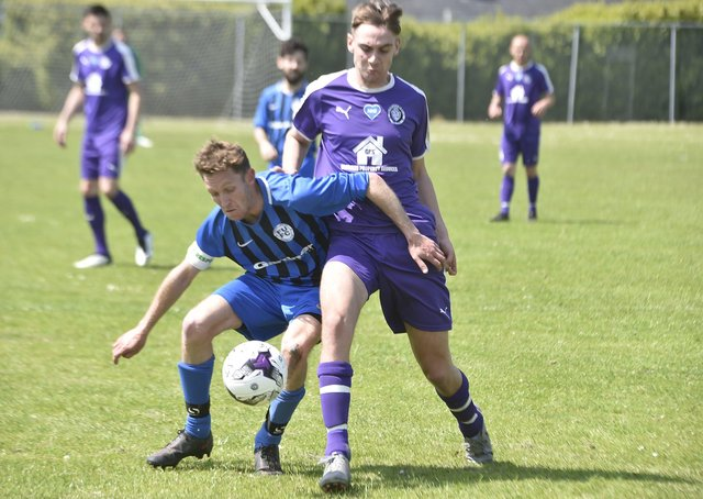 Action from Farcet United's Peterborough Junior Cup quarter-final win over Stanground Sports (purple) last weekend. They will play each other in Peterborough Division Two next season. Photo; David Lowndes.