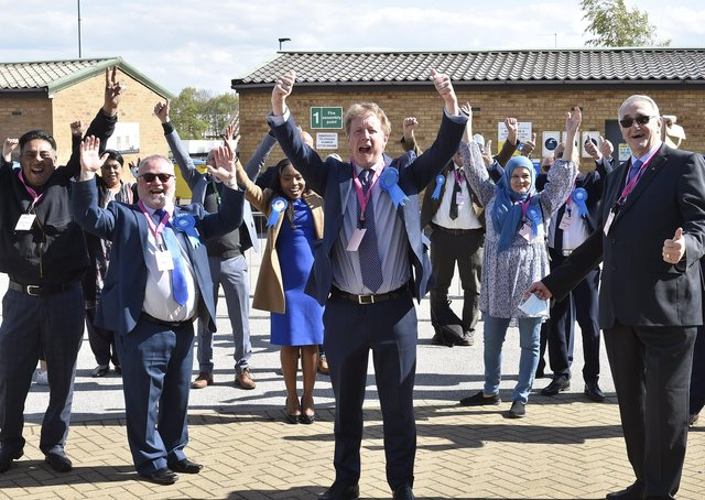 Comservative councillors celebrate with MP for Peterborough Paul Bristow after last month's election vote.