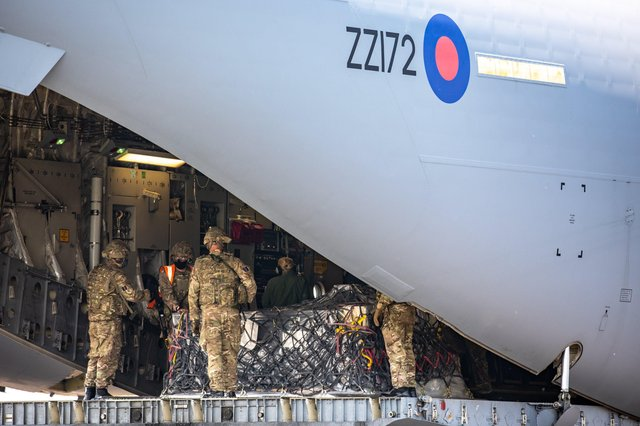 The team from 1AMW loading humanitarian cargo onto a C-17 Globemaster