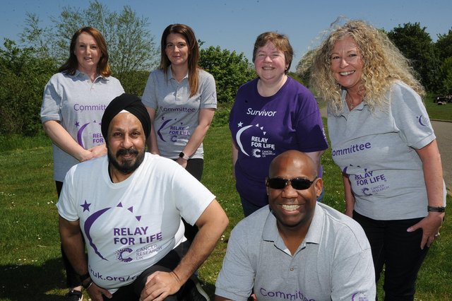 Organisers of the Peterborough Relay for Life with Deljit Singh -   Sharon Clapham, Sarah Sindall, Lisa McLoughlin, Tracey Yearwood and Jason Yearwood. pictured at the race venue at Ferry Meadows. EMN-210529-155120009