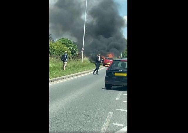 The car caught fire along London Road in Hampton.