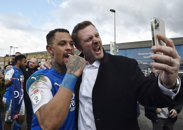 Posh co-owner Darragh MacAnthony (right) with Jonson Clarke-Harris after Posh sealed promotion from League One. Photo: David Lowndes.