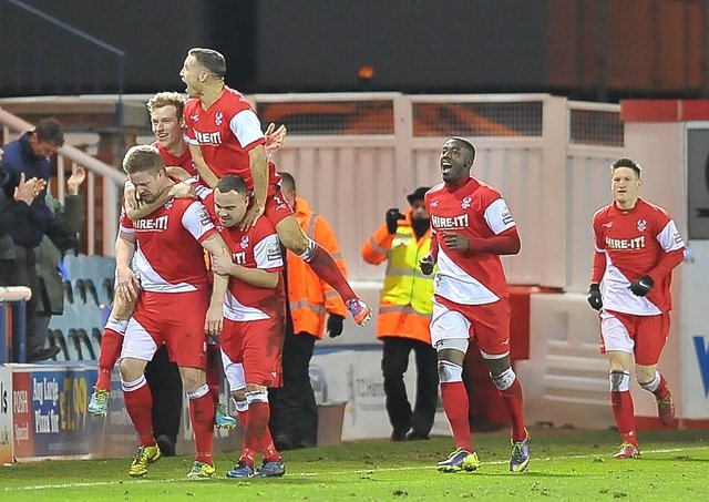 Michael Gash (front) after scoring for Kidderminster at Posh in 2014.