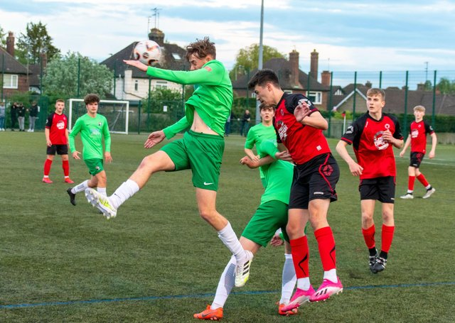 Action from Netherton United Under 18s (red) JPL title play-off defeat at the hands of Dereham.