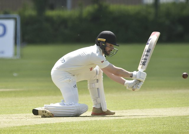 Chris Milner of Peterborough Town on his way to a first Northants Premier Division ton against Horton House last weekend. Photo: David Lowndes.
