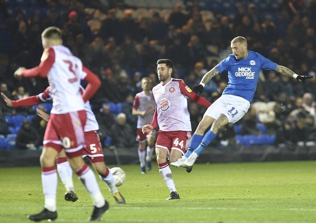 Marcus Maddison in action for Posh.