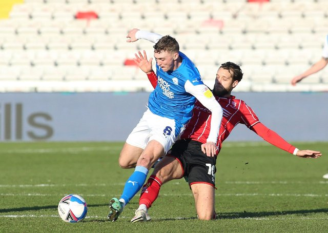 Jack Taylor (left) in action for Posh at Lincoln City last season.