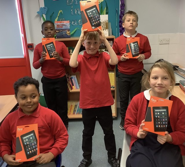 Pupils at Welbourne Primary Academy with their new tablets