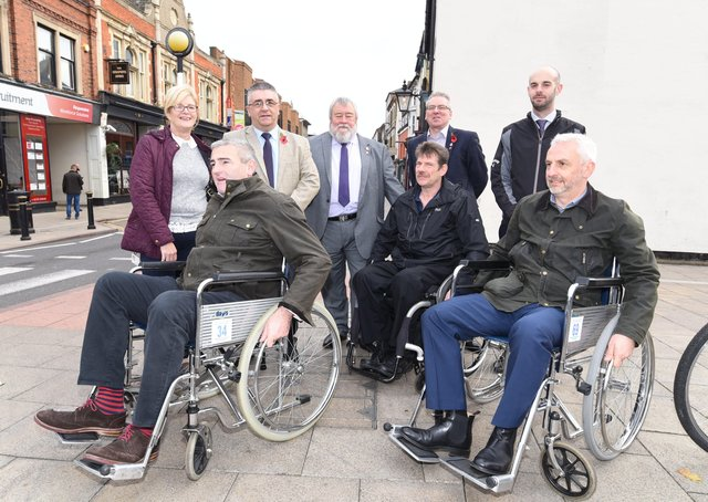 Stakeholders and people with disabilities touring the city centre in 2017. EMN-170211-132812009