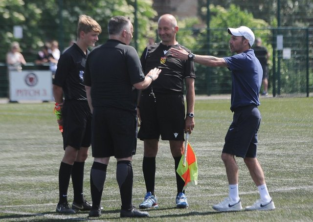 Yaxley Under 18s manager Danny Clifton argues with referee Paul Gale and his assistants. Photo: David Lowndes.