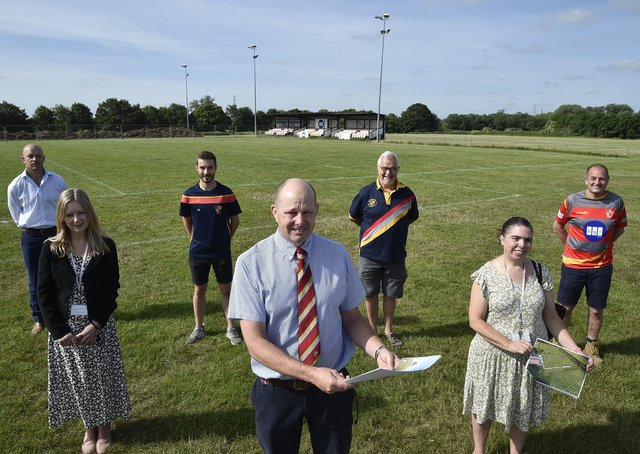 Peterborough Rugby Union Football Club president Andrew Burgess (centre) with Councillors Jackie Allen and  Samantha  Hemraj, former player Neil Duffield from London Rock, Tom Downer, Ian Hamilton and Archie Bennett from the club at the launch of new improvement plans for the venue.