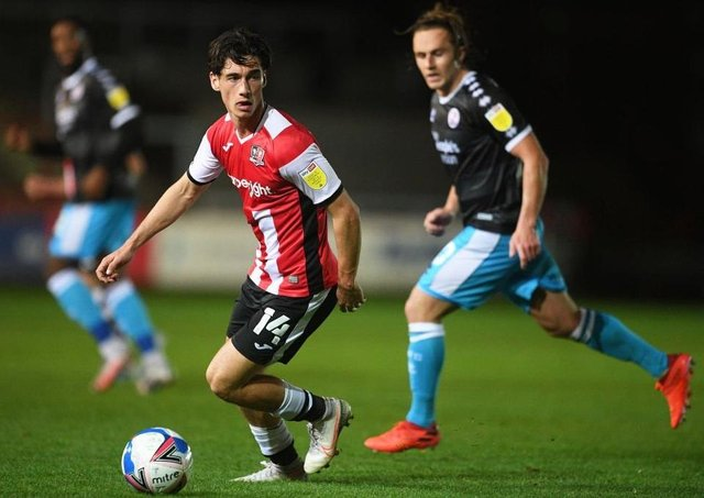 Joel Randall battles for the ball against Crawley. (Photo by Harry Trump/Getty Images)