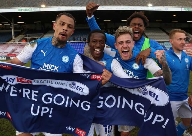 Peterborough United players celebrate winning promotion - Mandatory by-line: Joe Dent/JMP.