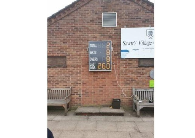 The scoreboard at The Greenfields, Sawtry.