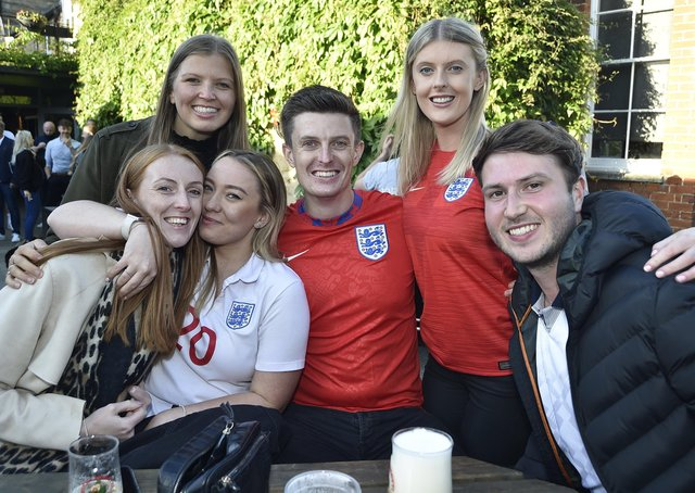 England fans watching the Czech Republic game at The Deeping Stage, Market Deeping. EMN-210622-212524009