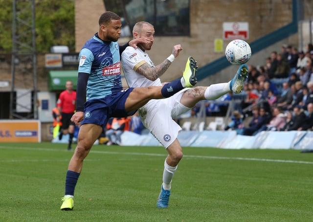 Marcus Maddison battles with Curtis Thompson of Wycombe. Photo: Joe Dent/JMP.