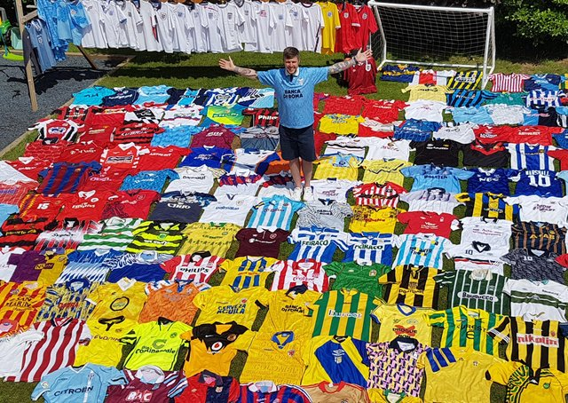 Pete with his collection of shirts.