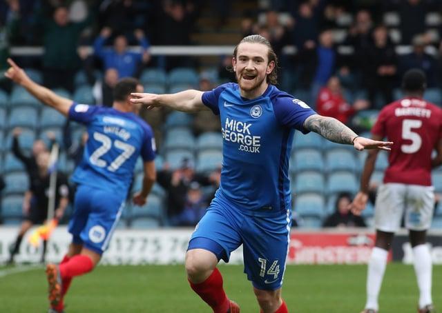 Jack Marriott celebrates a goal for Posh against Northampton Town.