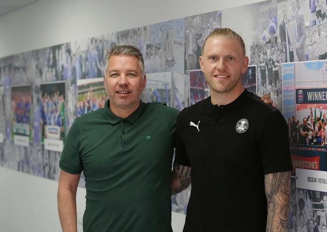 David Cornell (right) with Posh manager Darren Ferguson.