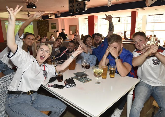 England fans at the Coyotes Bar, New Road, Peterborough EMN-210629-193348009