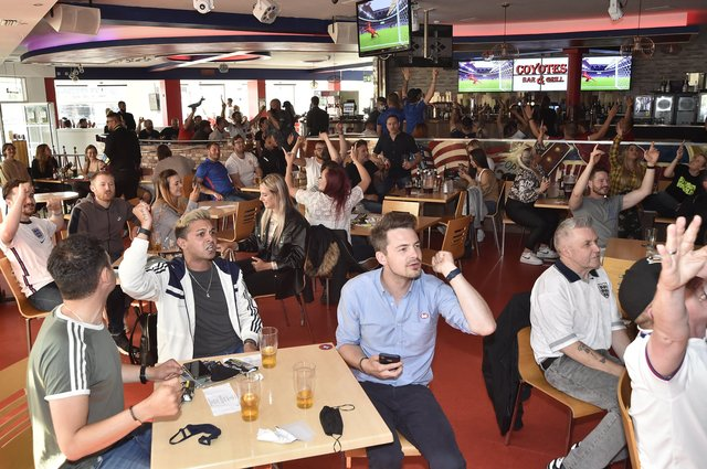 England fans at the Coyotes Bar, New Road, Peterborough EMN-210629-193410009
