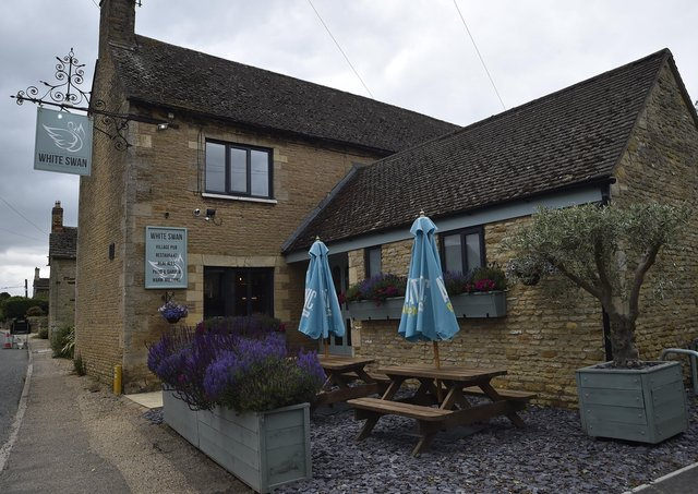 Interiors and exteriors of the White Swan pub in Woodnewton EMN-210629-193454009
