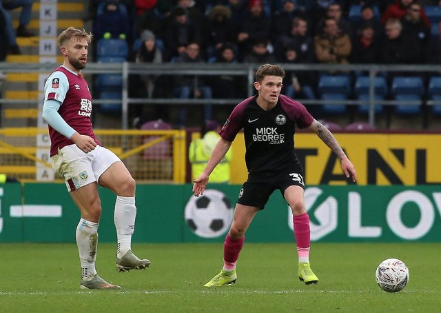 Kyle Barker playing for Posh in an FA Cup tie at Burnley.