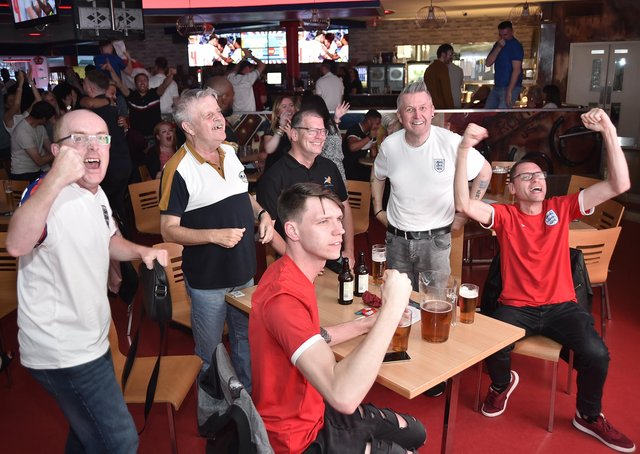 England football fans watching the Ukraine game at  Coyotes Bar and Grill at New Road EMN-210307-221051009