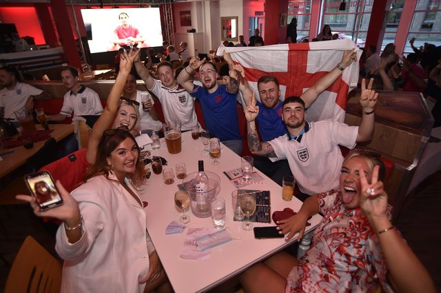 England football fans watching the Ukraine game at  Coyotes Bar and Grill at New Road EMN-210307-221325009