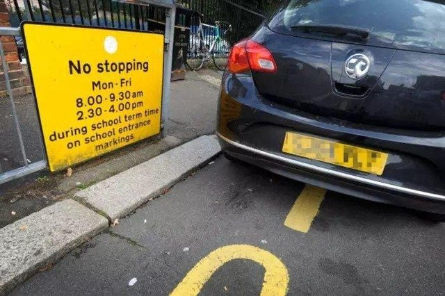 Illegal parking outside a school in Peterborough