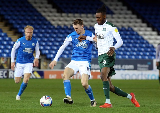 Jack Taylor (left) in action for Posh.