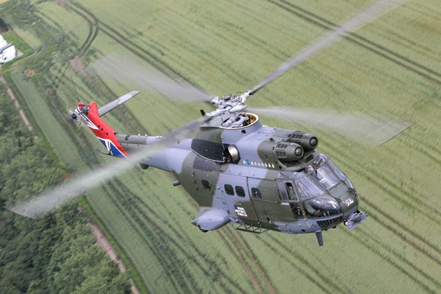 A 50th Anniversary Puma helicopter flies over the Oxfordshire countryside on 2nd July 2021.As part of the Puma 50th anniversary celebrations and commemorations, Puma HC Mk 2 XW224 has been re-painted in a unique paint scheme.  The aircraft scheme is similar to that which the first aircraft were painted when they were delivered in 1971 but with several notable differences. The engine housing boasts the badges of all squadrons who have flown the Puma, both as a HC Mk 1 and a HC Mk 2.  The tail fin is also emblazoned with the union flag.  On the cabin door, the standard Royal Air Force logo has been replaced with the bespoke Puma 50 logo and the cockpit door is annotated with the name of the first Squadron Commander who brought the aircraft into operational service.
