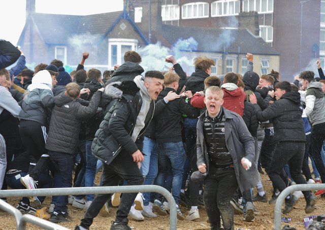 Posh fans celebrate outside the Weston Homes Stadium after promotion back to the Championship was clinched.