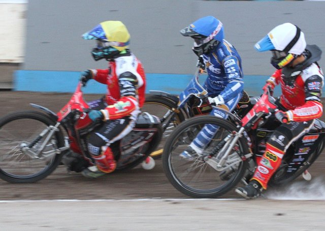 Ulrsih Ostergaard leads the way for Panthers at King's Lynn. Jordan Palin (white helmet) is also pictured. Photo: Derek Leader.