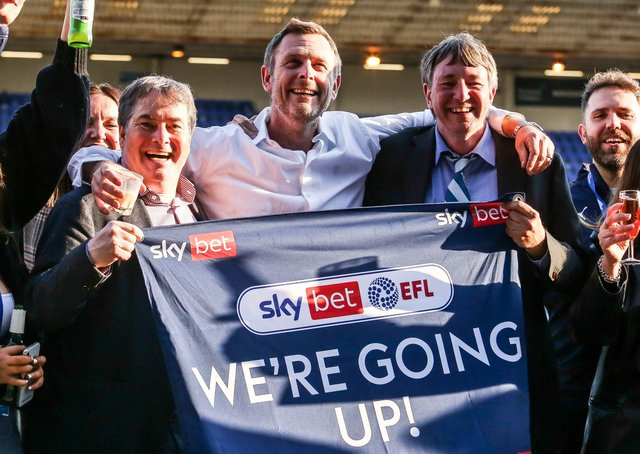 Posh co-owners, from left, Stewart Thompson, Darragh MacAnthony and Dr Jason Neale celebrate promotion to the Championship.