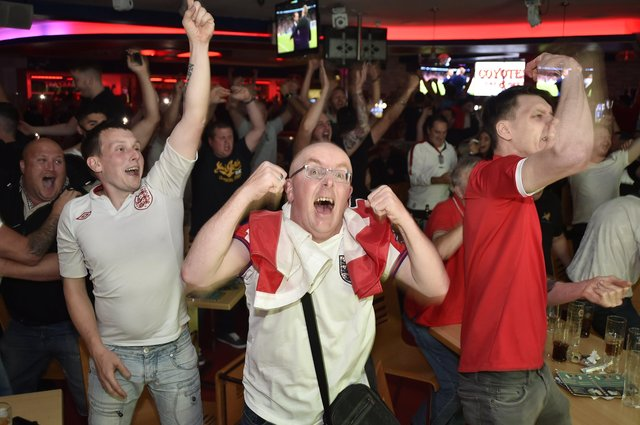 England fans watching the Euro 20 semi-final at the Coyotes Bar and Grill at New Road, Peterborough EMN-210707-230738009
