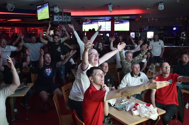 England fans watching the Euro 20 semi-final at the Coyotes Bar and Grill at New Road, Peterborough EMN-210707-231034009