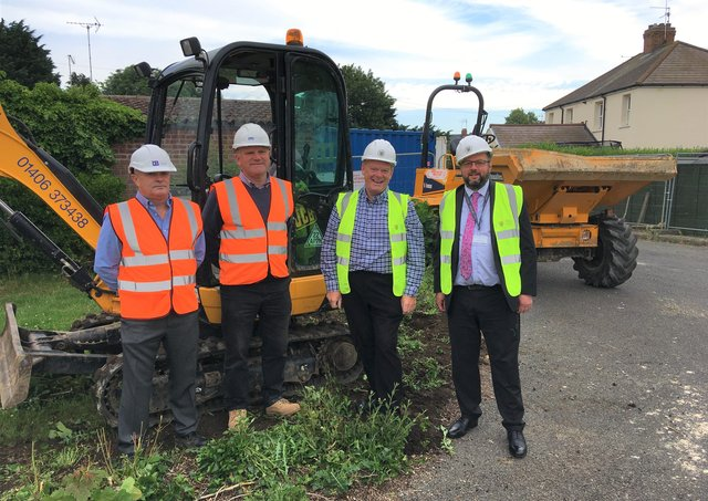 Senior Quantity Surveyor Sean Buxton and Contracts Manager Tony Hughes, both of D Brown Building Contractors, with SKDC Cabinet Member for Housing and Property, Coun Robert Reid, and SKDC Director for Housing and Property, Andrew Cotton. EMN-210807-151002001