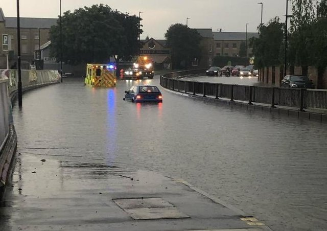 Flooding in Bourges Boulevard that left an ambulance needing to be rescued.